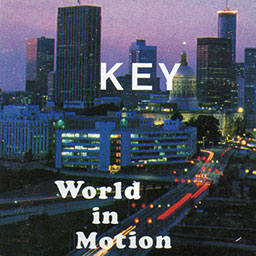 Key - World In Motion